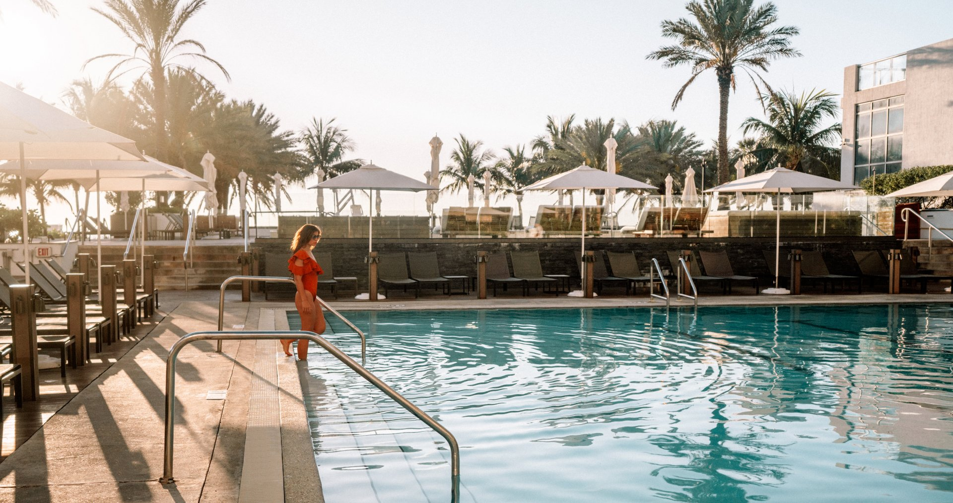 A woman entering the pool at Eden Roc, Miami Beach
