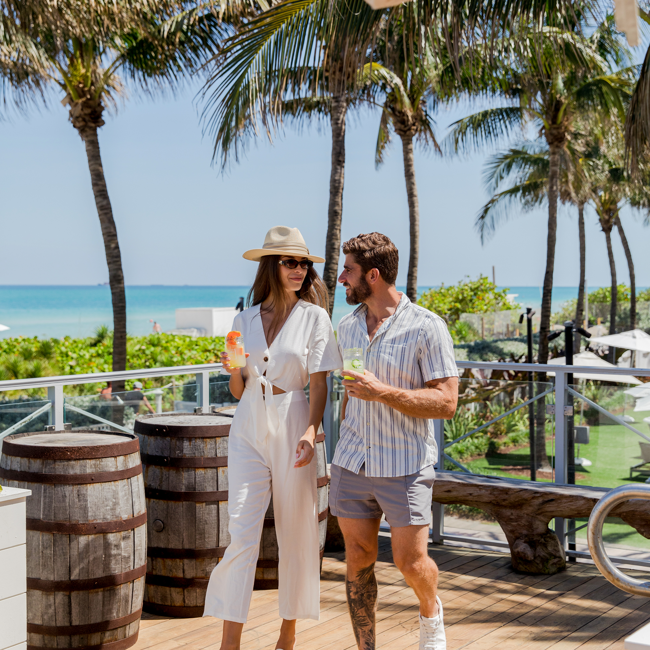 A couple enjoying drinks at Eden Roc, Miami Beach