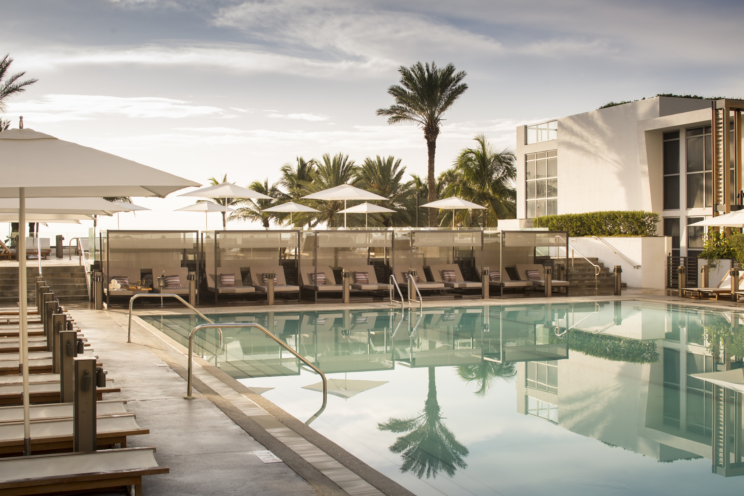 Swimming pool and sun loungers at Eden Roc