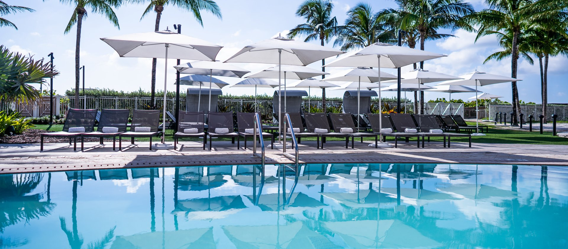 Pool and loungers at Eden Roc