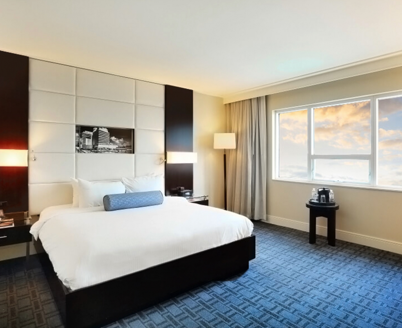 Large Bed in a deluxe bay view room at Eden Roc