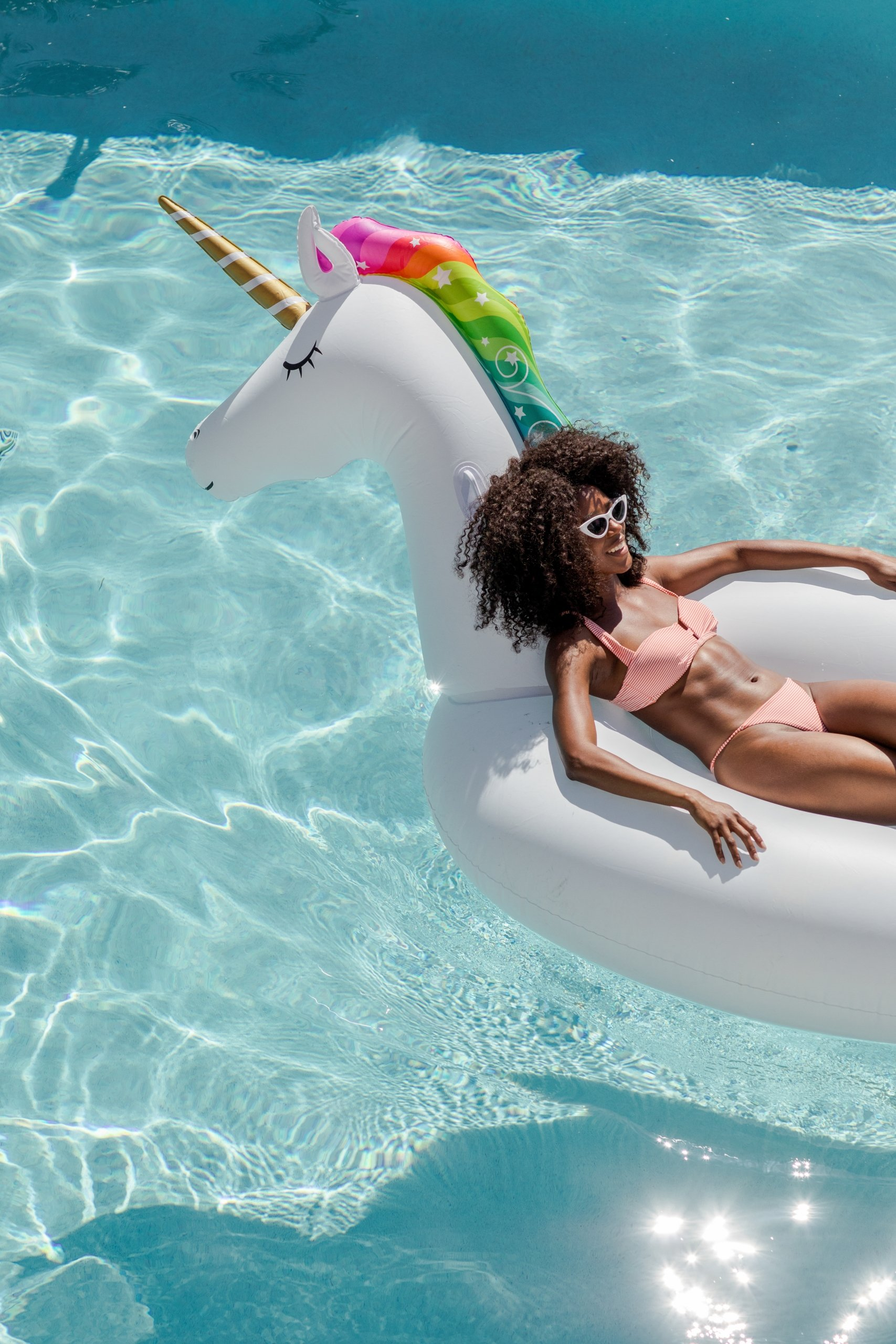 A woman relaxing in an inflatable in the pool at Eden Roc
